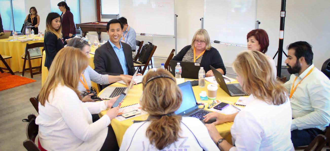 Lightning Bolt application consultant, Kevin Kim (top left), chats with users during a small group session.